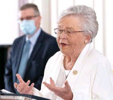 ?? MICKEY WELSH/THE MONTGOMERY ADVERTISER VIA AP ?? Alabama Gov. Kay Ivey gives a COVID-19 update at the Alabama Capitol Building in Montgomery, Ala., on Thursday. With states including Texas and neighboring Mississippi ending masking requirements, Ivey announced Thursday that masks will be required in the state of nearly 5 million people through April 9.