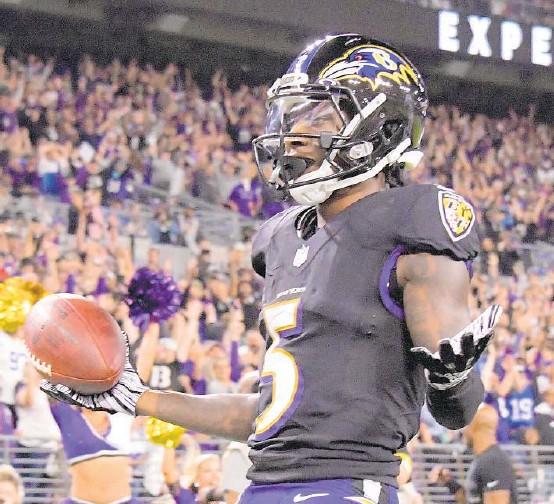 ?? KARL MERTON FERRON/BALTIMORE SUN ?? Ravens wide receiver Marquise Brown reacts after his third-quarter touchdown catch Monday night.