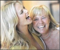 ?? Picture: DANNY MOLOSHOK /REUTERS ?? Charlize laughs with her mom Gerda at the premiere party of the film The Burning Plain in Los Angeles on September 14.