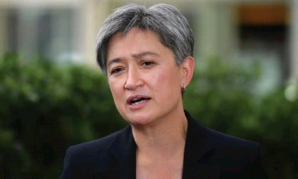 ?? Photograph: Mick Tsikas/AAP ?? Labor's Penny Wong says Australia's slowness to introducenew laws making it easier to impose sanctions against China for human rights abuses in Xinjiang sends 'a regrettable message'.