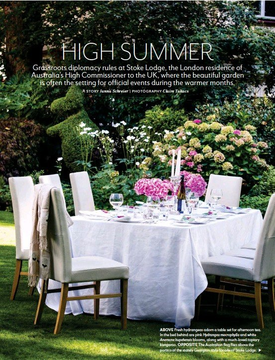 ??  ?? ABOVE Fresh hydrangeas adorn a table set for afternoon tea. In the bed behind are pink Hydrangea macrophylla and white Anemone hupehensis blooms, along with a much-loved topiary kangaroo. OPPOSITE The Australian flag flies above the portico of the...