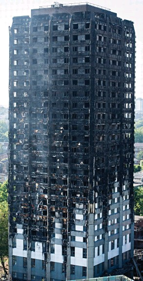 ??  ?? Charred: The melted cladding on the side of Grenfell Tower