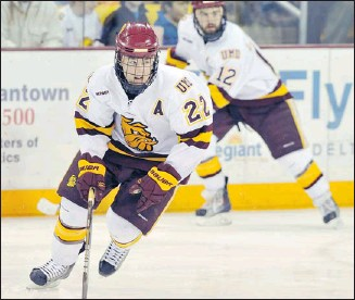 ?? Courtesy, University of Minnesota-Duluth ?? Calgarian Mike Connolly plays for the University of Minnesota-duluth and will skate in the nCaa Frozen Four men's hockey tournament against notre dame today.