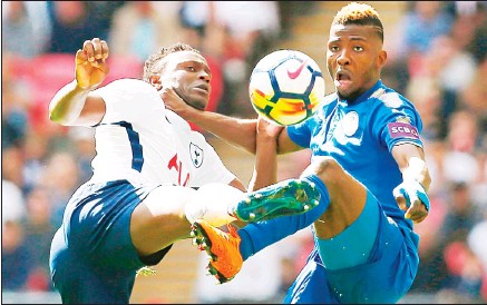 ??  ?? Tottenham Hotspur's Kenyan midfielder Victor Wanyama (left), vies with Leicester City's Nigerian striker Kelechi Iheanacho during the English Premier League football match between Tottenham Hotspur and Leicester City at Wembley Stadium in London on...