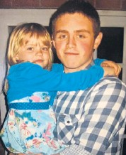 ??  ?? Amelia Adlam, as a child, in the arms of her stepbrother, Andrew Harper, a police officer who died while responding to the report of a burglary