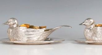?? © TOOVEY'S 2021. ?? A pair of Elizabeth II novelty silver duck sauce boats, London 1973, By Asprey & Co Ltd, length 21.5cm