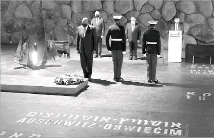 ?? Robert Burns/ The Associated Press ?? U.S. Secretary of Defense Lloyd Austin (left) with U.S. Marines laid a wreath during a memorial ceremony in the Hall of Remembrance at Yad Vashem in Jerusalem on Monday. He later traveled to Berlin to kick off his first European tour as defense secretary.