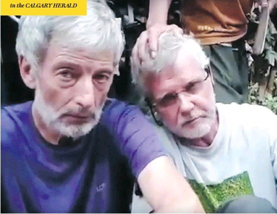 ?? YOUTUBE ?? Robert Hall, left, and John Ridsdel, as seen in a video released after they were abducted Sept. 21 in the Philippines. A plastic bag containing Ridsdel's head was found Monday.