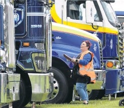 ??  ?? Taking it all in . . . Dunedin truck enthusiast Janine Harman inspects the big gear at the truck show.