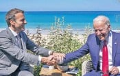 ??  ?? France's Emmanuel Macron and Joe Biden in Cornwall yesterday. The US president linked the infrastructure announcement to confronting China's Belt and Road scheme