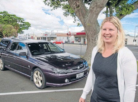 ?? Photo: JOHN NICHOLSON/FAIRFAX NZ ?? Wheel love: Vehicle saleswoman, and Holden lover, Felicity Cotter with her SS Commodore Crewman.