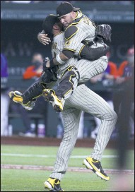 ?? AP PHOTO ?? San Diego starting pitcher Joe Musgrove, left, and catcher Victor Caratini celebrate Musgrove's no-hitter Friday against Texas.