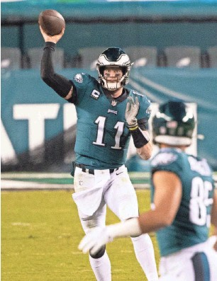 ?? BILL STREICHER / USA TODAY SPORTS ?? Quarterback Carson Wentz has probably played his last down for the Philadelphia Eagles.