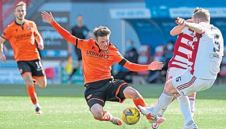 ??  ?? Dundee United's Jamie Robson and Hamilton's Brian Easton battle for the ball