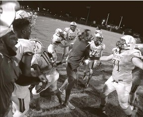 ?? DOUGLAS R. CLIFFORD   Times ?? Largo celebrates clinching the Class 6A, District 9 title after a 17-7 victory over rival Clearwater.