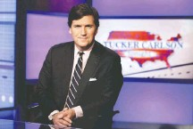 """?? RICHARD DREW/ASSOCIATED PRESS ?? Tucker Carlson's comment that immigrants make the United States """"poorer and dirtier and more divided"""" prompted some advertisers to yank their spots from his prime-time Fox News show."""