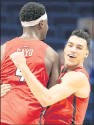?? MARK CORNELISON/SEC SERVICES ?? Forwards Nathan Cayo ( left) and Tyler Burton celebrated after URwon 76-64 Sunday at Kentucky. The victory elevated the Spiders to No. 19 in the AP Top 25.
