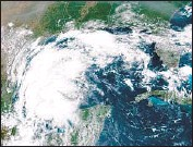 ?? Associated Press ?? TROPICAL STORM Nicholas, shown in the Gulf of Mexico in a satellite image, gained strength Monday.