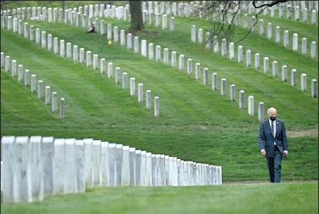 ?? Brendan Smialowski AFP/Getty Images ?? PRESIDENT BIDEN visits Arlington National Cemetery on Wednesday to pay his respects to Americans killed in the Afghanistan war.