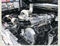 ??  ?? Lo­cated in the Scheid Diesel booth, it only made sense that a Scheid spec'd Cum­mins was parked un­der the hood of Lo­gan Yel­ton's 5.90 first-gen. The me­chan­i­cal 12-valve boasts one of Scheid's ported heads and its val­ve­train, a Light­ning 13mm P-pump, 5x.035 in­jec­tors, an in­di­vid­ual run­ner in­take man­i­fold, a wa­ter-to-air in­ter­cooler, and a Pro Mod 88mm turbo from Pre­ci­sion. The Cum­mins is backed up by a Lo­gan­built non-lockup 48RE that em­ploys a Go­erend con­verter and a trans­brake valve­body.