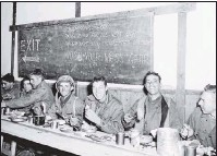 ?? THE ASSOCIATED PRESS ?? Members of a rifle teamof the Second Battalion, Fifth Marine Regiment, sat down for a Thanksgiving dinner in a mess hall in Chosin Reservoir, North Korea, on Nov. 23, 1950.