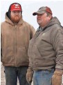 ?? COBURN DUKEHART/WISCONSIN CENTER FOR INVESTIGATIVE JOURNALISM ?? Andrew Bishop, left, and Bob Bishop stand on their farm in Cobb. The Bishop family plans to lease about 650 acres of agricultural land for Invenergy's Badger Hollow Solar Farm.
