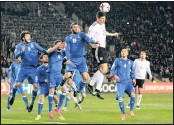 ??  ?? Germany's Mario Gomes, centre, heads for the ball during their World Cup Group C qualifying match against Azerbaijan at the Tofig Bahramov Stadium in Azerbaijan. AP Photo/Aziz Karimov