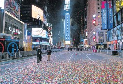 ?? THE ASSOCIATED PRESS ?? Confetti littered the street early Friday after theNewYear's Eve ball dropped in a nearly empty Times Square in NewYork. The areawas closed due to the pandemic.