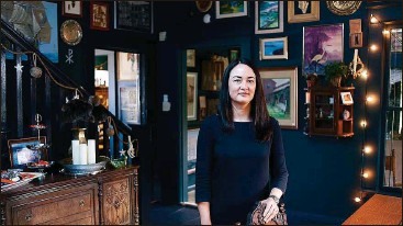 ?? Photos by OCTAVIO JONES | Times ?? Rose Wilson — a 41-year-old local estate planning attorney, not a witch — has filled the eight rooms of the house with an eclectic, sometimes chilling, collection of antique items. She does not live there, nor is it open to the public.