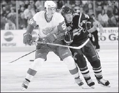 ?? Getty Images photo ?? DEFENCEMAN: Buffalo's Patrick Kaleta, right, skates against Detroit's Jonathan Ericsson at HSBC Arena in Buffalo, N.Y.