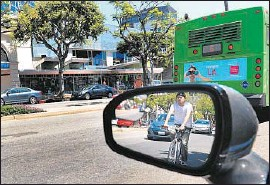 ?? Wally Skalij Los Angeles Times ?? ADVOCATES forWestwood bike lanes say students need a safe way to get to campus, but opponents argue the lanes would lead to traffic congestion.