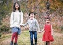 ?? Courtesy ?? Olivia, 11, Edison, 8, and Colette Nguyen, 5, died in a fire last week in Sugar Land.