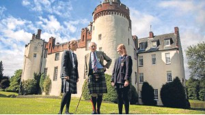 ?? Picture: Paul Reid. ?? Lord Airlie with Emma Duncan of Dundee High School, left, and Michaela Lennox of Morgan Academy at Cortachy Castle.