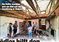 ??  ?? Die Helfer machten sich ein Bild von der Zerstörung in Stebno.