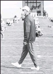 ?? Courtesy photo / University of Colorado ?? Colorado head coach Karl Dorrell watches his team's first practice on Friday.