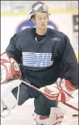 ?? Star photo: Dan Janisse ?? MINDING THE NET: Windsor Spitfires starting goalie Andrew Engelage practises Monday at Windsor Arena.