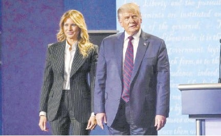 ?? (Photo: ap) ?? President Donald Trump stands on stage with First Lady Melania Trump after the first presidential debate on September 29, 2020. Both have since tested positive for the novel coronavirus.