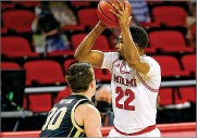 ?? E.L. HUBBARD / CONTRIBUTED ?? Miami's Myja White, guarded by Western Michigan's Jason Whitens on Jan. 30, scored a career high 14 points in Saturday's 64-51 loss to Kent State at Millett Hall.