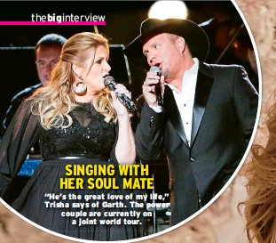 """??  ?? SINGING WITH HER SOUL MATE """"He's the great love of my life,"""" Trisha says of Garth. The power couple are currently on a joint world tour."""