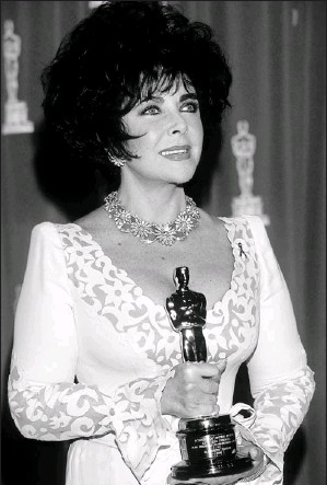 ?? By Kevin Mazur, WireImage ?? This one isn't for a movie: Elizabeth Taylor received an Oscar for the Jean Hersholt Humanitarian Award at the 1993 Academy Awards. She founded two organizations to help AIDS patients and research.