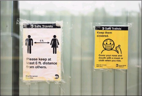?? Tyler Sizemore / Hearst Connecticut Media ?? Signs promote social distancing and use of face masks on the platform of the train station in Greenwich.