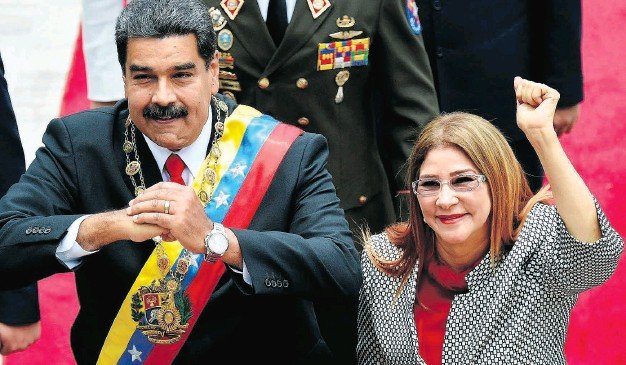 """?? FEDERICO PARRA / AFP / GETTY IMAGES ?? Venezuelan President Nicolas Maduro and his wife Cilia Flores, who has been described as her husband's """"strong arm."""""""