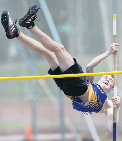 ?? PHOTO: GERARD O'BRIEN ?? Up and over . . . Taieri athlete Cole Gibbons clears the bar in the open pole vault at the Caledonian Ground on Saturday. Gibbons won the grade.