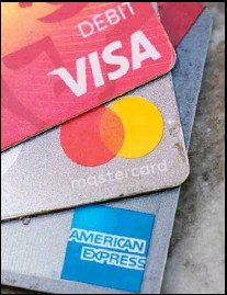 ??  ?? American Express, Visa and Master card cards on display in Richmond, Virginia, Thursday, July 1, 2021. (AP)