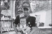 ?? BEN CRUMP LAW PLLC VIA THE AP ?? Daunte Wright is shown with his son, Daunte Jr. Wright, 20, was killed during a traffic stop by a white suburban Minneapolis police officer on Sunday.