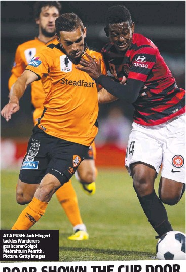 ??  ?? AT A PUSH: Jack Hingert tackles Wanderers goalscorer Golgol Mebrahtu in Penrith. Picture: Getty Images