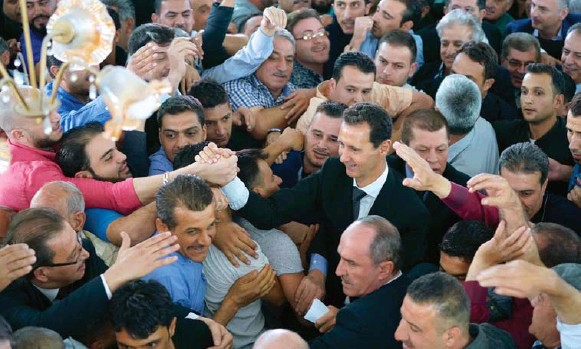 ?? HANDOUT VIA AFP/GETTY IMAGES ?? The Syria that President Bashar Assad once ruled with an iron grip is now fractured into volatile fiefdoms. He has been weakened, with Russia and Iran becoming major players in Syria's affairs.