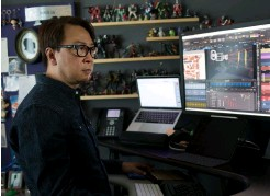 ??  ?? Right: Cine­matog­ra­pher and lay­out artist Pa­trick Lin hard at work on one of Pixar's fea­ture films