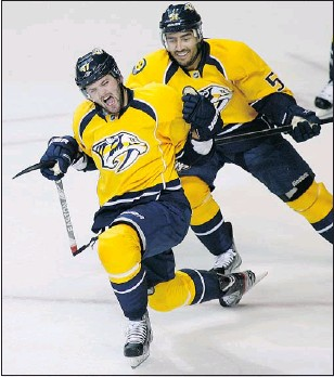 ?? — REUTERS ?? Nashville's Alexander Radulov (left) celebrates scoring against Detroit with Francis Bouillon in Round 1. Whether he'll return from suspension with Andrei Kostitsyn hasn't been decided, says Preds coach Barry Trotz.