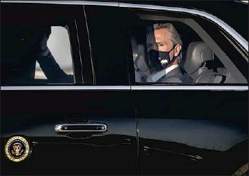 ?? Gina Ferazzi Los Angeles Times ?? GOV. GAVIN NEWSOM joins President Biden's motorcade after an election eve rally in Long Beach. The governor's political near-death experience could inspire him to make changes, or at least a show of gratitude.